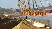 Welded-steel-pipes-are-lowered-into-trenches-Northern-Greece-November-2016.jpg