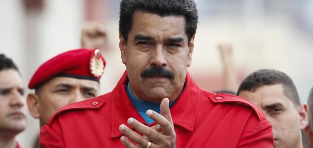 Maduro-manos-ceremonia2aniversariomuertechavez-635-reuters.jpg -