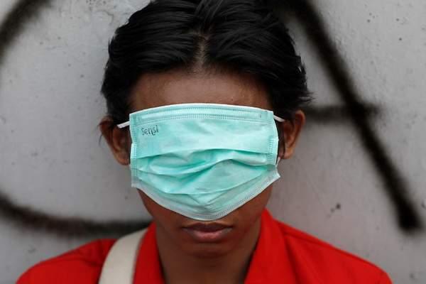 ☣ CORONAVIRUS ☣ - Minuto y Reconfinado - Vol.134: Desescalada 2.0 - Página 19 600x400_coronavirus-mascarilla-nino-indonesia-reuters