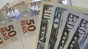 reales-y-dolares-dinero-reuters.jpg