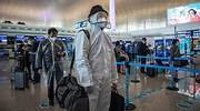 pasajeros-cola-aeropuerto-wuhan-770-efe.jpg